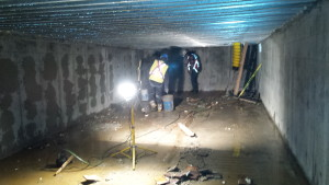 Workers finish cleaning out a water retention tank beneath a parkade project in downtown Kamloops.